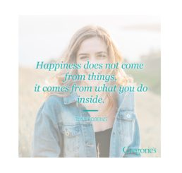 HAPPINESS DOES NOT COME FROM THINGS, IT COMES FROM WHAT YOU DO INSIDE. TONY ROBBINS QUOTE OVER A PHOTO OF A SMILING WOMAN.