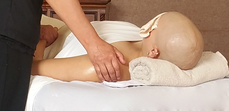 massage therapist working on an oncology client.