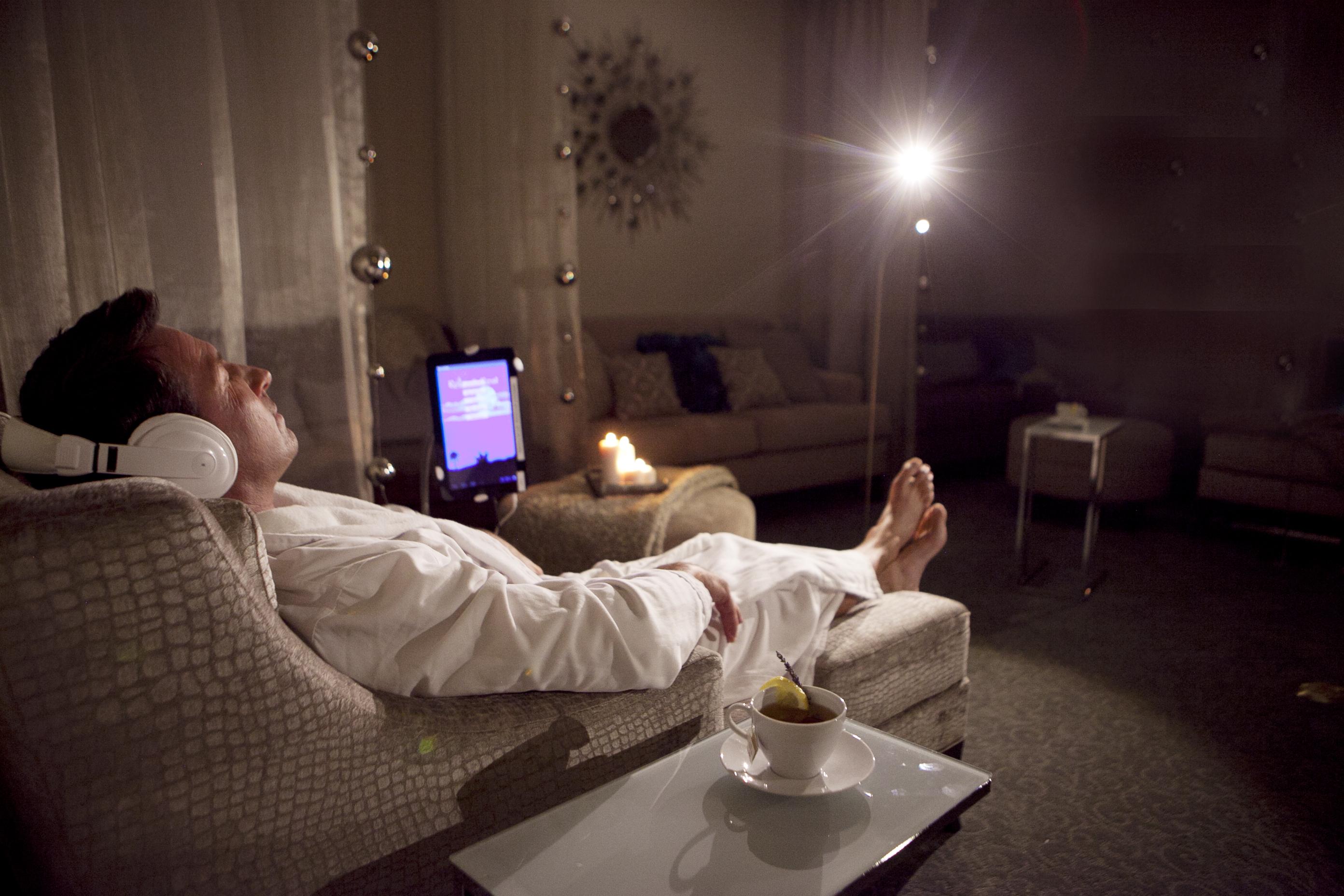man relaxing at meditation station